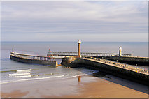 NZ8911 : Piers and Extensions, Whitby Harbour by David Dixon