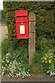 TF6423 : Elizabeth II postbox on  Nursery Lane, North Wootton by JThomas