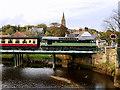 NZ8909 : NYMR Diesel Train Crossing the Railway Bridge at Ruswarp by David Dixon