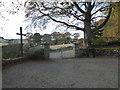 NJ6906 : Gated vehicular egress from Midmar Kirkyard by Stanley Howe