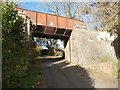 ST0782 : Disused railway bridge over the road, Rhiwsaeson by John Lord