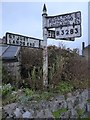 SW4025 : Old roadsign in St Buryan by Philip Halling