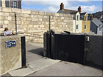 SY6873 : Small floodgate, Chesil Cove, Chiswell, Portland by Robin Stott