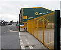 SD5805 : Yellow entrance gate, Travis Perkins, Wigan by Jaggery