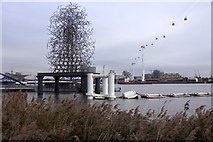 TQ3980 : Art, pier and cable car, North Greenwich by Mike Pennington