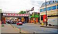 TQ2168 : Malden High Street, at New Malden station 2001 by Ben Brooksbank