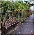 SS9597 : Metal bench above the Rhondda River, Ynyswen by Jaggery