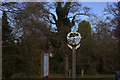 TL3758 : Hardwick village sign by Robert Eva