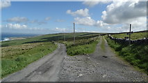 M1304 : Road & track junction at Faunarooska, The Burren by Colin Park