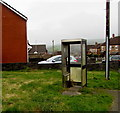 SS9087 : Shell of a former phonebox, Y Wern, Bettws by Jaggery