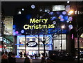 TQ2881 : Boots, Oxford Street, with Christmas lights by David Hawgood