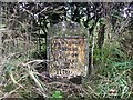 NY2243 : Old Milestone by the A595, west of High Waverbridge by CF Smith