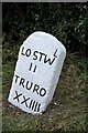 SX1261 : Old Milestone by the A390, south of Little Fairy Cross by Ian Thompson