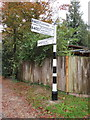 SP5213 : Fingerpost in Mill Street, Islip by John S Turner