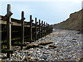 TG1643 : Sea defences and cliffs at Sheringham by Mat Fascione