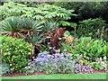 SZ4083 : A flower border at Mottistone Manor by Steve Daniels