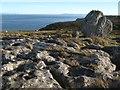 SH7584 : Limestone pavement with boulder by Jonathan Wilkins