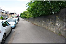 SE1633 : Parked cars and stone wall of Midland Road by Roger Templeman
