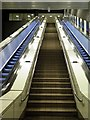 NZ2464 : Steps & escalators, St James Metro Station by Andrew Curtis