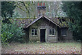 TA1404 : Woodland cottage in Garter Wood by Ian S