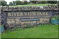 NZ0515 : Caravan park sign by Bob Harvey