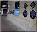 SJ3250 : Six blue plaques on the wall of platform 1, Wrexham General railway station by Jaggery