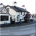 SJ3057 : Photographer in High Street, Caergwrle, Flintshire by Jaggery
