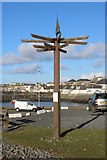 NX3343 : Signpost at Port William Harbour by Billy McCrorie