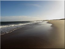 NZ2796 : Waves breaking on Druridge Bay by Graham Robson