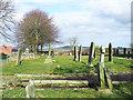 NZ3351 : Gravestones at west end of St. Matthew's Church by Trevor Littlewood