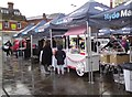 SJ9494 : Traders setting up in the rain by Gerald England