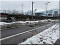 ST3188 : Small mounds of snow alongside the entrance to  Market Square bus station, Newport by Jaggery