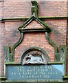 NS7993 :  Carving and inscription above the Filling Station by Gerald England