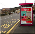 SN4701 : Santander advert on a Pwll Road bus shelter, Pwll, Carmarthenshire by Jaggery