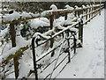 SX9064 : Snow on gate near Torre Station by Derek Harper