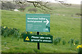 TQ3405 : Lawn Memorial & Woodland Valley Natural Burial Ground signs by Adrian Cable