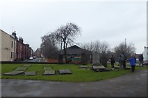 SE2932 : Graves in the former Churchyard by DS Pugh
