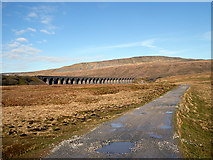 SD7579 : Ribblehead Viaduct and Whernside by John Lucas