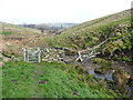 SE0135 : Gate on footpath alongside Dunkirk Beck, Oxenhope by Humphrey Bolton