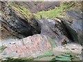 SS5747 : Cave entrances in the cliff adjacent to Combe Martin beach, Devon by Derek Voller
