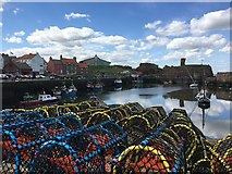 NT6779 : Piles of Coloured Creels at Victoria Harbour Dunbar by Jennifer Petrie