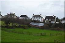 SX9575 : Houses and barn by N Chadwick
