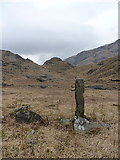 NM9199 : Small 'standing stone' beside shieling huts by Richard Law