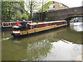"TQ3283 : ""Tintagel"" narrowboat goes under Wharf Road bridge by David Hawgood"