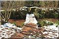 SX8963 : Footbridge over Cockington Stream in the snow by Derek Harper