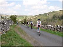 SD9772 : Tour de Yorkshire - returning spectators by bike by Stephen Craven