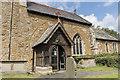 TA1703 : South porch, Holy Trinity church, Swallow by Julian P Guffogg