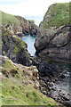 SM7022 : The rocky southern coast of Ramsey Island by John Dalling