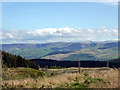 SH7204 : Pennal Uchaf and a view over the Dyfi Valley by John Lucas
