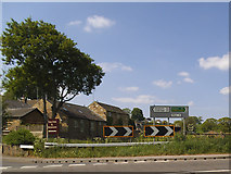 SE2443 : Road signs on the A660 in Bramhope by Stephen Craven